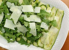Zucchini Carpaccio Recipe with zucchini, lemon, extra-virgin olive oil, salt, pepper, baby arugula, shaved parmesan cheese