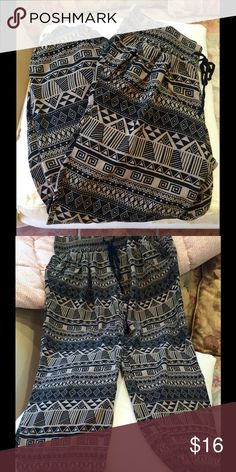"Eye Candy Harem Pants, Size Medium Black/brown tribal print pants.  Size medium tag, but for small best.  Inseam 25"" and waist 28"".  Worn ONCE! Eye Candy Pants Ankle & Cropped"
