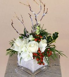 Holiday in the Snow Gorgeous blooms of hand-chosen white Roses, White Dendrobium Orchids imported from Thaliand, Holly, EVergreens, and bran. Christmas Flower Arrangements, Holiday Centerpieces, Christmas Flowers, Christmas Table Decorations, Floral Centerpieces, Floral Arrangements, Peonies Centerpiece, Poinsettia Flower, Christmas Vases