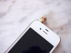 Skull dust cap for phone. Super cute.