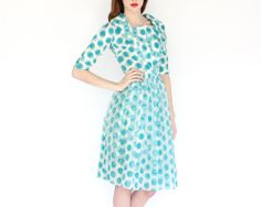 vintage 50s optical illusion polka dot teal white sheer party dress. $132.00, via Etsy.