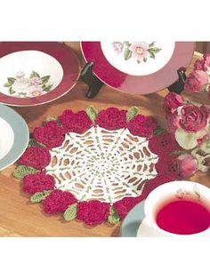 """Rose Petal Doily- A treasured flower for hundreds of years, the rose is one of summer's masterpieces!  Doily size: 9"""" (appx)  Skill level: Intermediate  Designed by Maggie Weldon  free pdf from FreePatterns.com"""