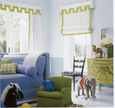 I love the hand-painted circus scene on the chest and the circus tent  valances. Reed Krakoff