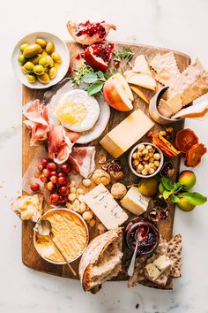 How to Build a Cheese Board: Wow your holiday guests with a masterfully made board that invites partygoers to graze over the goods. Here's how to choose the cheeses, the pairings and the serving style for your next holiday soirée.