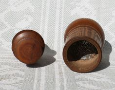 "19th century treenware spice grinder. It has a ""pestle"" type cap which has a tin grater attached and a corresponding grater piece in the grinder's body. It is in excellent and usable condition. It shows a nice old nut-brown patina and good wear. Approx. 5.5"" high"