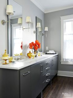 Incorporate the cool colors of granite and concrete into your paint for a contemporary twist on gray. Dark wood floors warm up the hue, while bright white trim adds palette-brightening contrast to ensure the result isn't drab. A black vanity provides a final touch of sophistication. Paint Color: Ozark Shadows, Benjamin Moore