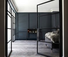 There is something so damn sexy about a dark, minimalist space. Dramatic architecture and decor...