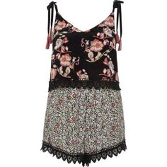 I'm shopping Black print playsuit in the River Island iPhone app.