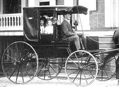 the family in their horse carriage