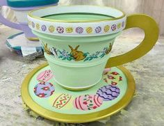 by @Jeff Raum,  using stencil designs from Designer Stencils.  This giant teacup is part of the Easter Bunny set at The Oaks mall in Thousand Oaks, CA.