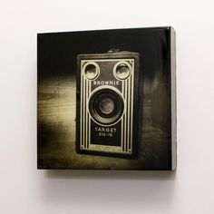 Sepia Brownie - A classic 10x10 photograph of a vintage Kodak Brownie camera, mounted on board and resined. On Etsy, $180.00