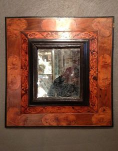 Huguenot mirror in marquetry, 17th century  Double mirror frames inlaid inverted profiles of native wood (ash, walnut, boxwood ...) Acanthus decorated with foliage and oval reserves and heart in the corners. These mirrors were used by Protestants to hide their bible at the back. Hearts symbolize the struggle (peak) and the union between the community (curved inwards). Original mercury mirror. Through a slightly warped. Work of Languedoc circa 1680-1700