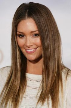 Subtle caramel highlights on brown, straight, long layered hair.