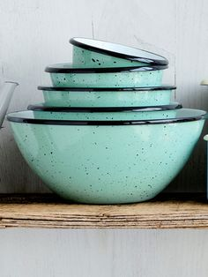 Speckled enamelware bowls in a luscious aqua color ~ Country Living, October 2013