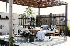 patio inspiration...LOVE the lattice of natural branches behind.