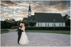 bride and groom in front of chapel at whitestone inn at sunset