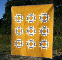 Brighten the Corners quilt — threaded quilting studio