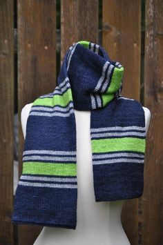 Created to the exacting specifications of a diehard Seahawks fan, this scarf will keep the cold out and show your Seattle hometown pride. Knit in the round for a double layer of warmth whether you wear it at the stadium or just around town. Best of all, the knitting is simple enough that you can work on this while watching the game!For most knitters, there should be enough yarn left over (especially in the contrast colors) to complete the set with a simple hat pattern of your choice. Colors…