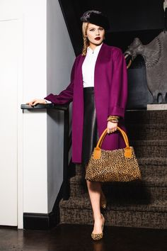 Shamask magenta cardigan coat ($1988,Jamie), The Row white zip front shirt ($998,Jamie); The Wrights black leather skirt ($75, The Private Label); Ceri Hoover cheetah print satchel ($395, Stacey Rhodes Boutique); Loeffler Randall cheetah print pumps ($350, Shoe Salon at Jamie); Judith Bright Rockstar black spinel nugget earrings ($248,Judith Bright); Modital Bijoux gold triple bangles ($198,Jamie); Modital Bijoux 3 tone bangles ($198,Jamie); Kate's Boutique black mink hat ($75,The…