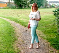 Soft whites and pastels summer outfit: Rose print sheer layered top \ mint trousers chinos pants \ nude crossover mules \ orange tinted aviators \ coral clutch | Not Dressed As Lamb, over 40 style