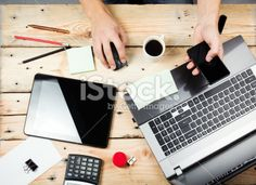 Man at wooden table with laptop and smartphone Royalty Free Stock Photo Get thrilling discounts on images, illustrations, Videos and music clips at iStockphoto with Coupon.