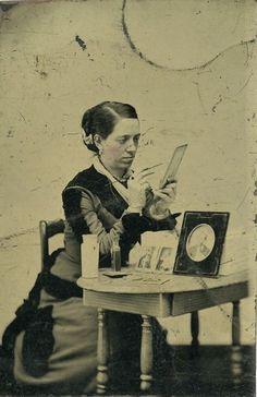 "ca. 1900, [tintype portrait of Henrietta ""Lilla"" Kenney handpainting photographs],  via Harvard University's Schlesinger L..."