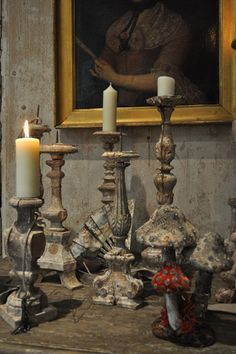 Vignette collection of candle holders with great patina.
