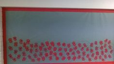 WW1 display, I used a potato cut in half to print the poppy and then a finger print of black to make the centre. I then looped galvanised wire over, securing with crossed staples to represent the barbed wire.