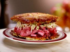 Latke Corned Beef Sandwich with Apple and Sour Cream Slaw from FoodNetwork.com...two latkes are a bit much for me - I think I would serve this open face