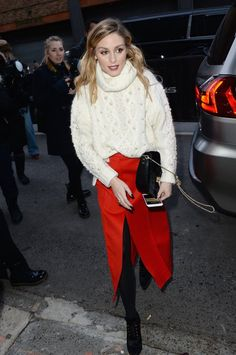 While running around New York Fashion Week, Olivia dressed down a slit skirt with a cozy turtleneck, a styling tip you could likely put to use with the pieces already in your closet.