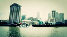 Stock Footage | The skyline of New Orleans, as seen from a cruise ship sailing down the Mississippi River. | Download using the VidLib app. 50.000 Royalty Free Clips'
