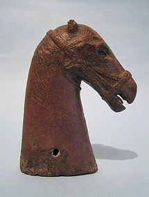 "Rare South Arabian Bronze Horse Head Protome, circa 2nd Century BCE - 1st Century CE. Engraved mane and inlaid eyes beneath heavy ribbed brows. Braided harness with blinders behind eyes. Two holes for attachment at bas of neck. Missing one ear but otherwise in excellent condition. 4 1/2"" high. Ex: Property of Santa Barbara Museum of Art. A breed of horse that originated on the Arabian Peninsula."