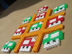 Mario Tic Tac Toe perler beads - make to address fine motor and visual motor skills (planning, coordination, grasp development; spatial relation skills) by sally tb Melty Bead Patterns, Pearler Bead Patterns, Perler Patterns, Perler Bead Mario, Diy Perler Beads, Pearler Beads, Art Perle, Hama Beads Design, Pokemon