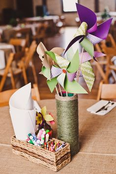 Skip a floral centerpiece and opt instead for something interactive and fun at the kids' table.  Photo by Sarah Q Photography via Style Me Pretty