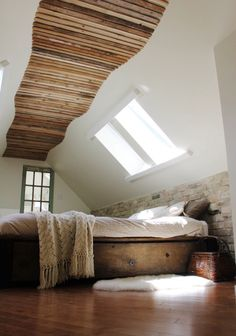 Love combo of varying stained wood planks on ceiling with stone on the wall!