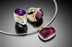 Taboo Studio | Owners Jane Groover and Joanna Rhoades This photograph includes a one-of-a-kind white and yellow gold pendant with a yellow diamond and a rare 48-carat purple tourmaline. Shown on a white gold cable, it can be purchased for $3,400. Along with the pendant are two large cabochon rings on sterling silver bands with 22k gold bezels. The 22-carat amethyst ring in a size 7 is $863, and the 30-carat purple tourmaline ring, also a size 7, is $2,365.