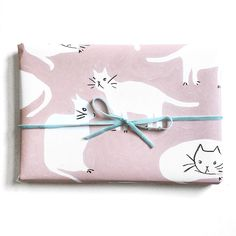 "by emily isabella. ""It's even more fun to give the cat wrapping paper to your friends who don't like cats."""