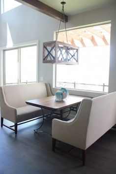 Settees and Dining Table...make a nook out of nothing! If you backed one or both of the settees with a sofa table or credenza it would make it look even more 'built in'. A great option for a rental space!