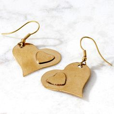 Earrings with heart. Noah's Ark has supports its makers and their families with fair wages that are 10 to 15 per cent higher than local earnings, and even helps send makers' children to school. These double-heart earrings change lives.