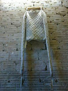 Child's Straight Jacket hangs on display.