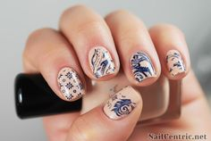Nude dragon stamped nail design