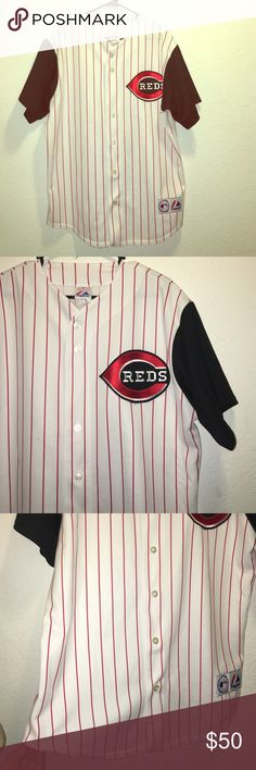 Cincinnati Reds MLB White Striped Majestic Jersey Cincinnati Reds Blue sleeve, white & striped jersey. In good condition. Some small flaws near the bottom right. Black marks. Can be seen in picture 3. Size Large Majestic Shirts