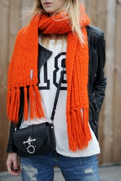 Sport chic with black and white top and bright orange scarf for casual outfit