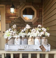 Who doesnt love cotton? Create that perfect farmhouse theme with a gorgeous mason jar centerpiece! This would go perfect on an entryway table or a centerpiece for your kitchen table. Package includes (1) 6 jar planter box 26x5.5X3.5 (6) 1 quart sized mason jars (6) flowers (2) installed