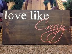 """Country Music Wooden Signs - Decorative signs with lyrics from Tim McGraw, Taylor Swift, Lee Brice, and more! These handcrafted wooden signs feature lyrics from your favorite country songs. They make great pieces for home decor, photo props, and party/wedding decorations! This one features lyrics from Lee Brice's """"Love Like Crazy."""""""