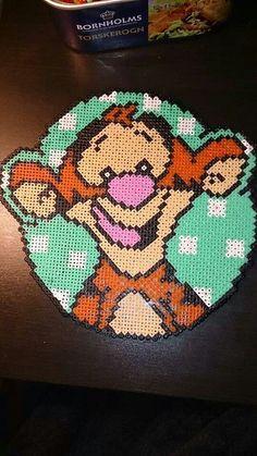 Tigger - Winnie perler beads by Nadja Jensen / Pattern: http://www.pinterest.com/pin/374291419002859332/