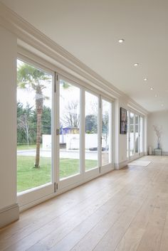 Painted white timber bi-fold doors to grand residential property in Hove, Sussex.