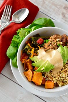 The Bowl of Crazy   Inspired by the dish from Blooming Beets Restaurant in Boulder, this dish is made of delicious slow cooked pulled pork, a rainbow chard and carrot hash, cauliflower rice, roasted sweet potato wedges, and a smoky aioli to top it all off!