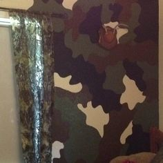 Hand painted camo wall. I penciled the design, figured out which color would go where, then painted. My son loves it!