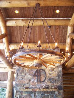 """Oregon Trail""Wagon Wheel Chandelier made from an authentic antiqueWe made three of these for Camp David! -Custom lighting fixtures by Roc C..."